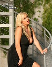 Rachel Aziani in sexy black dress from Busty Rachel