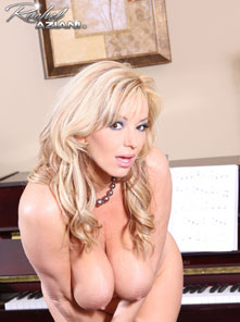 Rachel Aziani Spreading in front of Piano from Busty Rachel