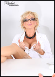 Rachel Aziani in a sexy secretary business suit from Busty Rachel