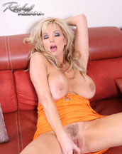 Rachel in a tight orange dress showing off her hairy little pussy from Busty Rachel