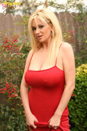 I was out shooting in LA along with a few of the other Aziani models. Tyler Faith was sweet enough to let me borrow her sexy red dress. I have to say it fit like a glove...it even held up by big natural boobies without a bra which isn't always easy.. from Busty Rachel